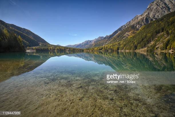 autumn at lago di anterselva 3 - spiegelung stock pictures, royalty-free photos & images