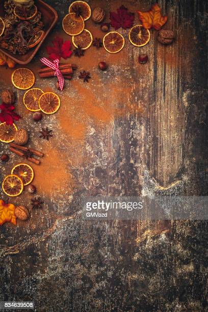 autumn background with nuts, spices and candied oranges - country christmas stock pictures, royalty-free photos & images