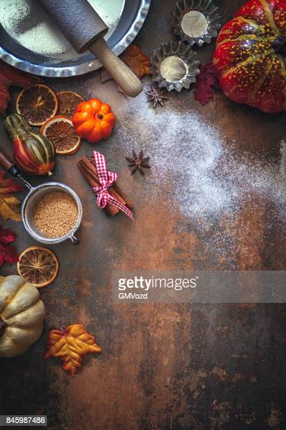 autumn background with nuts, spices and candied oranges - november background stock photos and pictures