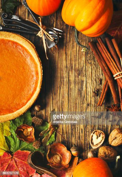 autumn background with pumpkin pie, pumpkins, nuts and spices - happy thanksgiving card stock pictures, royalty-free photos & images