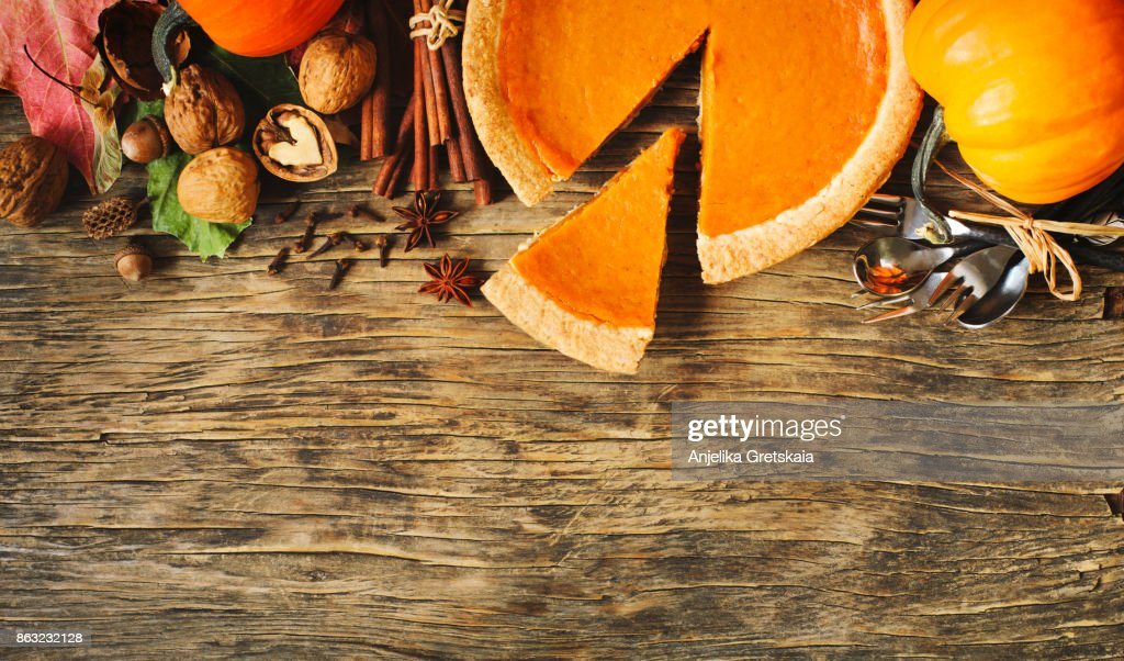 Autumn background with pumpkin pie, pumpkins, nuts and spices : Stock Photo