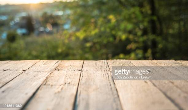 autumn background with red leaves wooden planks - bench stock pictures, royalty-free photos & images