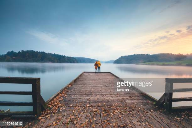 autumn by the lake - jetty stock pictures, royalty-free photos & images