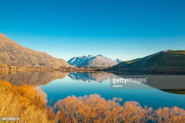 autumn by the lake - queenstown stock pictures, royalty-free photos & images