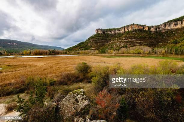 autumn cloudy landscape with mountain wall and lake, cuenca, spain - cuenca provincia de cuenca fotografías e imágenes de stock