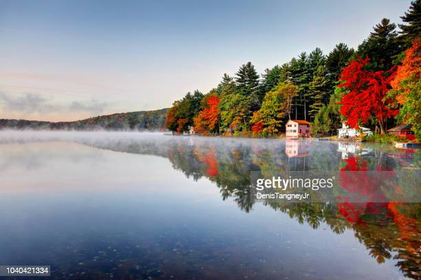 autumn colors along lake mattawa in the quabbin region of massachusetts - massachusetts stock pictures, royalty-free photos & images