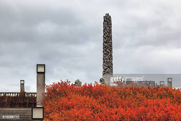 Autumn colors in Gustav Vigeland park  with the monolith sculpture.