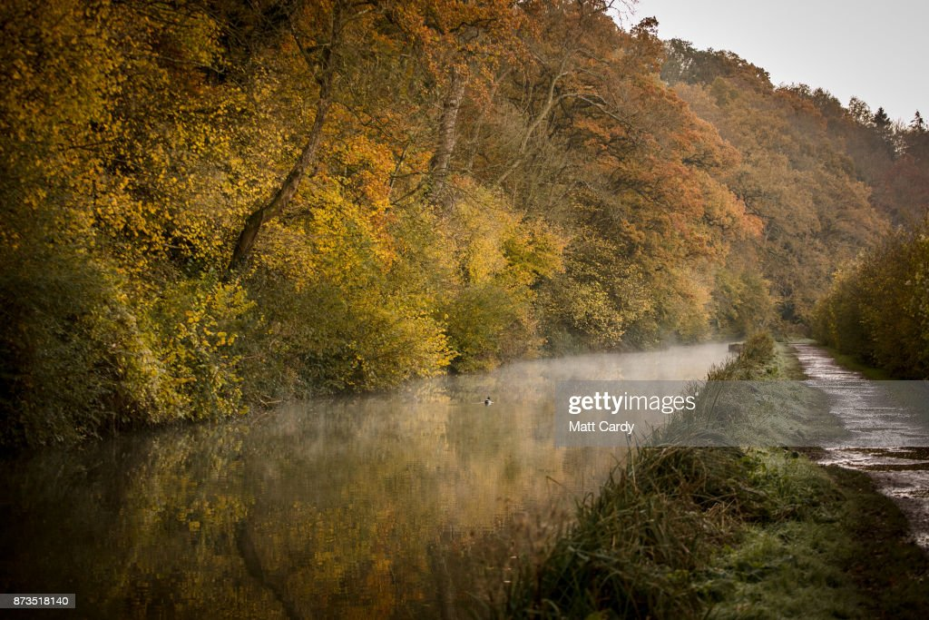 Autumn colours from the trees are reflected in the water of the Kennet and Avon canal near the Dundas Aqueduct as the sun rises on November 13, 2017 near Bath, England. After a warm autumn, with temperatures above average, much colder weather has arrived in many parts of the UK, signalling the start of more wintery weather for the coming few weeks.