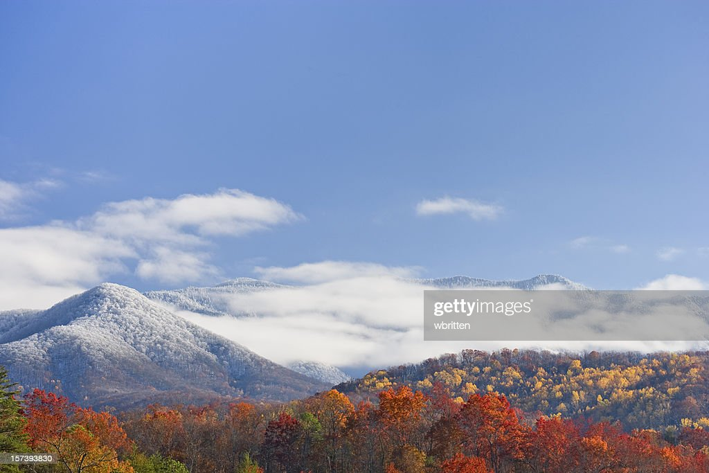 Autumn day with snowfall on the mountains : Stock Photo