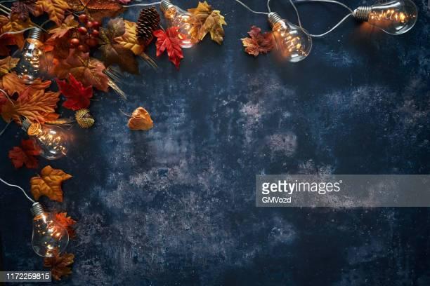 autumn decoration with leafs on rustic background - novembro imagens e fotografias de stock