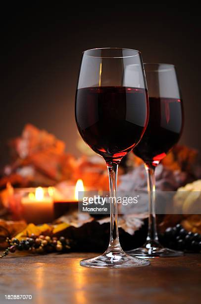 Autumn decoration with wine and candle light