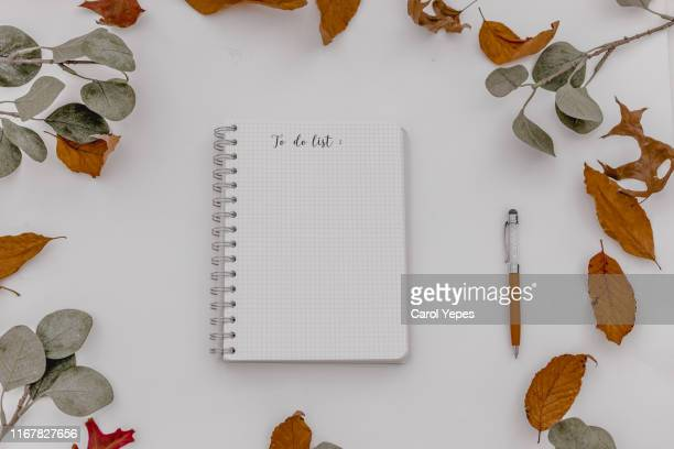 autumn, fall workspace composition. notebook mock-up scene. - top foto e immagini stock