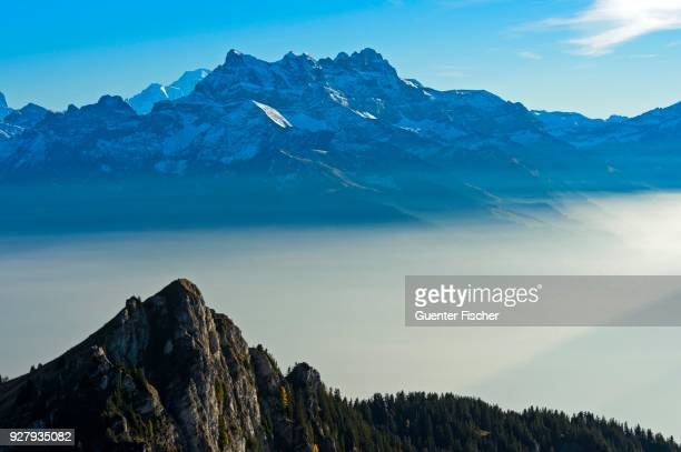 autumn fog in the rhone valley, summit of the dents du midi, leysin, vaud, switzerland - leysin stock photos and pictures