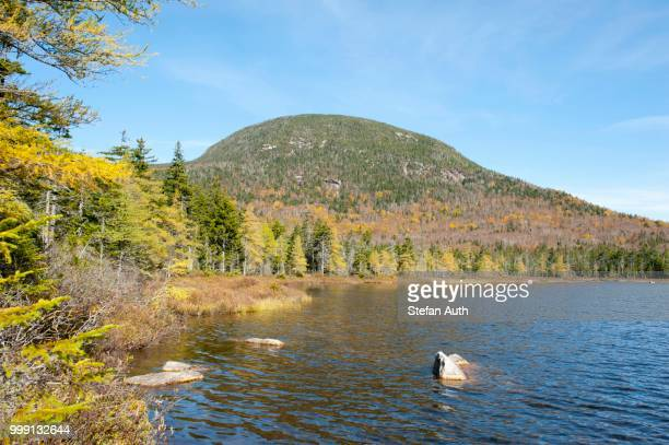 Autumn foliage, Indian Summer at Lonesome Lake, looking towards Cannon Mountain, Franconia Notch State Park, White Mountains National Forest, New Hampshire, New England, USA