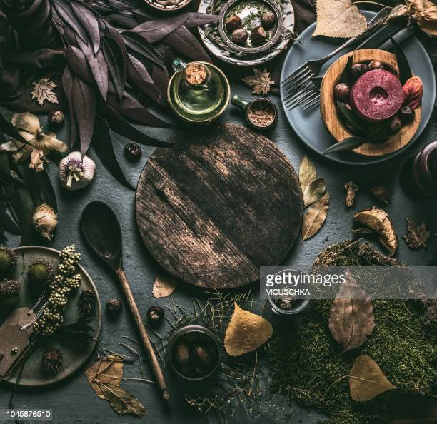 Autumn food background with forest decoration for mushrooms or venison food or cooking