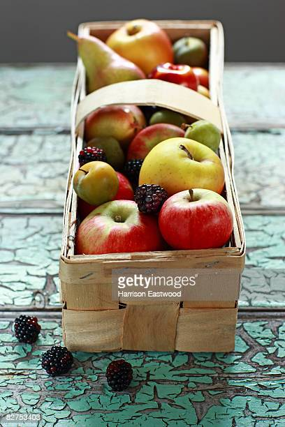 Autumn Fruits in wooden punnett on table