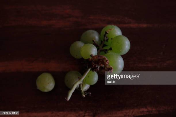 Autumn grapes on wooden table