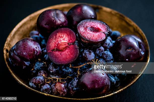 autumn harvest:grape and plums - juicy stock pictures, royalty-free photos & images