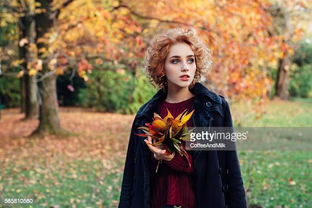 Autumn зhoto of a beautiful girl