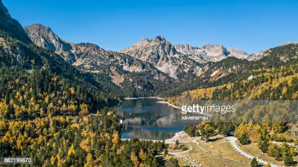 autumn in sant maurici lake, pyrenees, catalonia, spain - catalonia stock pictures, royalty-free photos & images