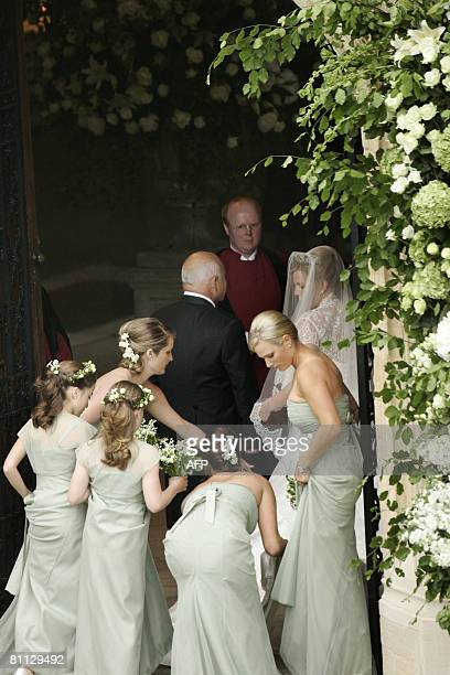 Autumn Kelly 31 is led into St George's Chapel in Windsor on May 17 2008 by her father Brian Kelly and British royal family member Zara Phillips to...
