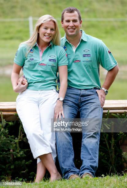 Autumn Kelly and Peter Phillips pose for photographs following their engagement announcement as they attend the Festival of British Eventing at...