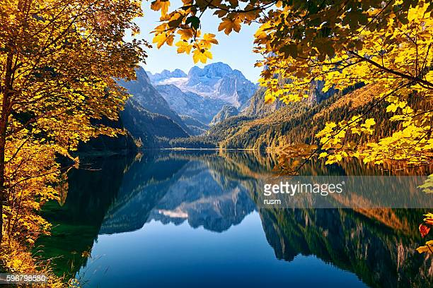 autumn lake gosausee in salzkammergut, austria - austria stock pictures, royalty-free photos & images