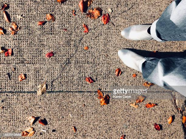 autumn leaves on ground - silver boot stock pictures, royalty-free photos & images