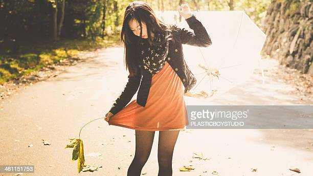 autumn leaves / umbrella / one piece / fallen leav - long sleeved stock photos and pictures