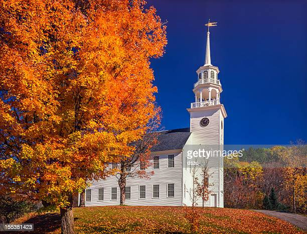 autumn maple trees frame New England Village Square and TownHall