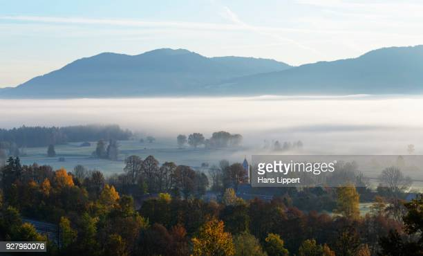 Autumn mood, morning mist over Loisachtal, village Zell near Grossweil, Oberbayern, Bavaria, Germany