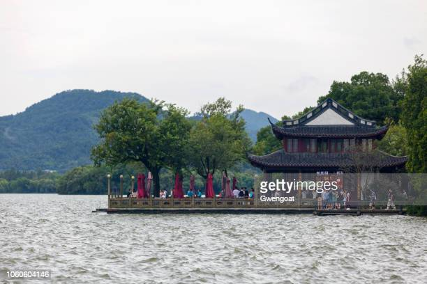 autumn moon on calm lake in hangzhou - gwengoat stock pictures, royalty-free photos & images