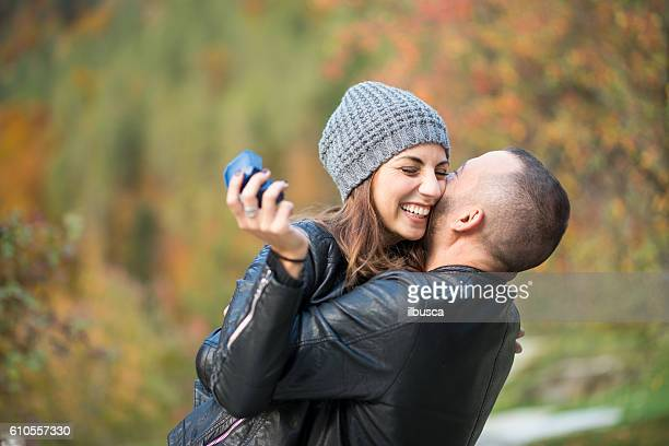 autumn outdoor wedding proposal engagement - man holding engagement ring stock photos and pictures