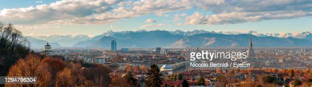 autumn panorama of the city of turin torino piedmont, italy with the surrounding alps mountains - turin stock pictures, royalty-free photos & images