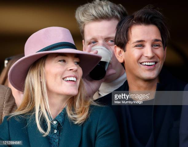 Autumn Phillip and Ollie Locke watch the racing as they attend day 4 'Gold Cup Day' of the Cheltenham Festival 2020 at Cheltenham Racecourse on March...