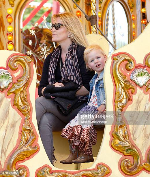 Autumn Phillips and daughter Isla Phillips ride on a merrygoround as they attend day 4 of the Royal Windsor Horse Show in Home Park on May 16 2015 in...