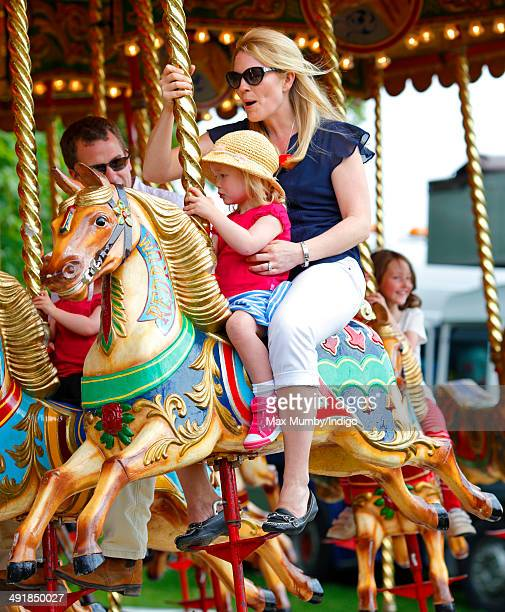 Autumn Phillips and daughter Savannah Phillips ride a merry go round during day 4 of the Royal Windsor Horse Show at Home Park on May 17 2014 in...