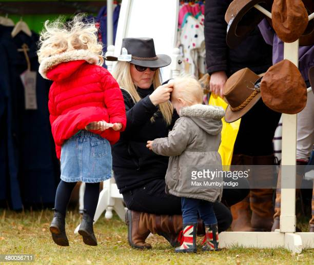 Autumn Phillips and daughters Isla Phillips and Savannah Phillips try on hats as they attend the Gatcombe Horse Trials at Gatcombe Park...