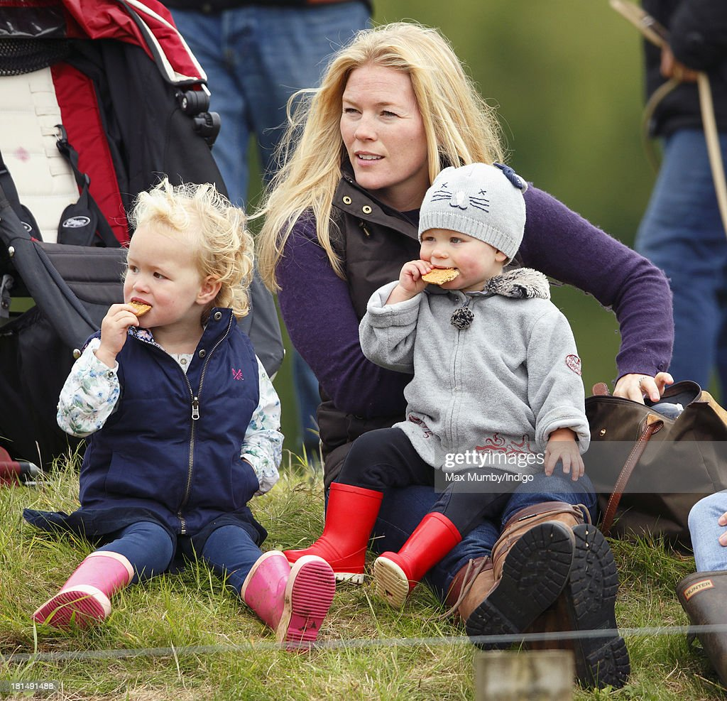 Autumn Phillips and her children Savannah Phillips (left) and Isla Phillips (right) watch the cross country phase of the Gatcombe Horse Trials at Gatcombe Park, Minchinhampton on September 21, 2013 in Stroud, England.