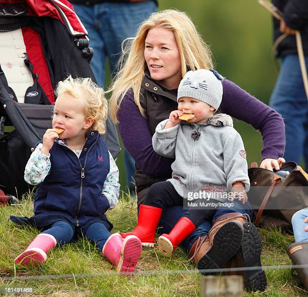 Autumn Phillips and her children Savannah Phillips and Isla Phillips watch the cross country phase of the Gatcombe Horse Trials at Gatcombe Park...