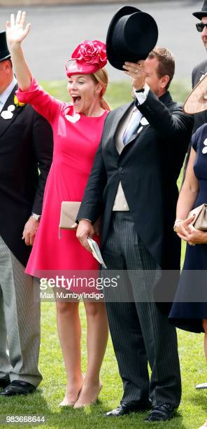 Autumn Phillips and Peter Phillips wave as Queen Elizabeth II's carriage procession passes by on day 5 of Royal Ascot at Ascot Racecourse on June 23...