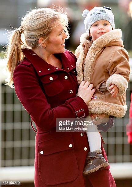 Autumn Phillips carries daughter Isla Philips as they attend the Christmas Meeting at Ascot Racecourse on December 20 2013 in Ascot England