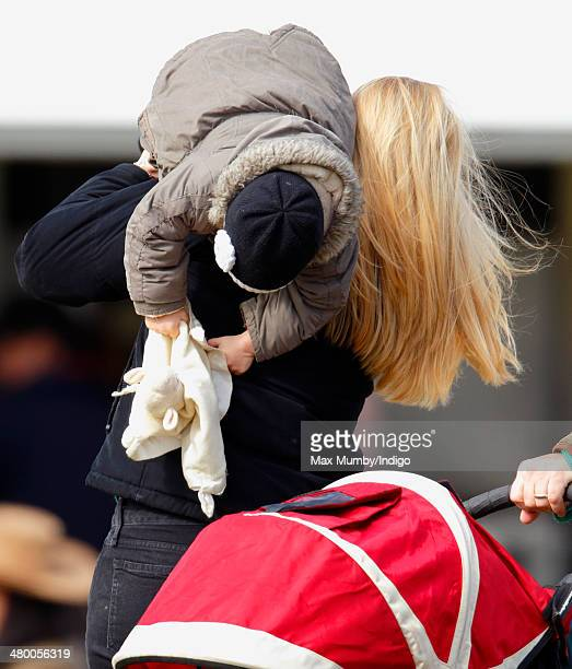 Autumn Phillips carries daughter Isla Phillips as they attend the Gatcombe Horse Trials at Gatcombe Park Minchinhampton on March 22 2014 near Stroud...