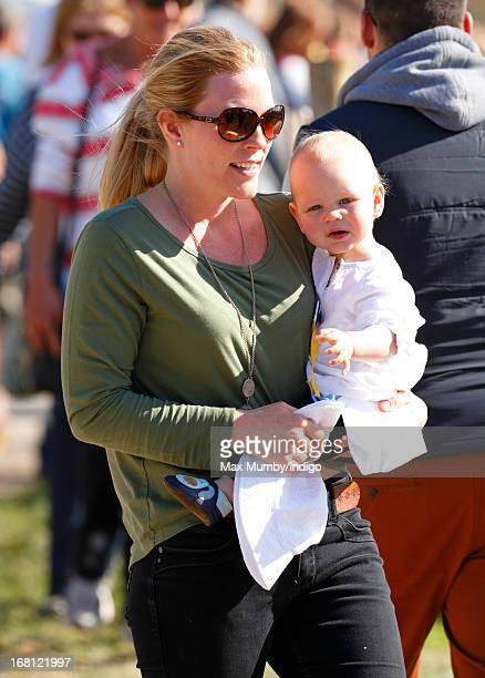 Autumn Phillips carries her daughter Isla Phillips as they attend day 4 of the Badminton Horse Trials on May 5 2013 in Badminton England