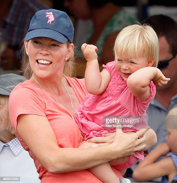 Autumn Phillips carries niece Mia Tindall as she attends day 3 of the Festival of British Eventing at Gatcombe Park on August 9 2015 in Stroud England