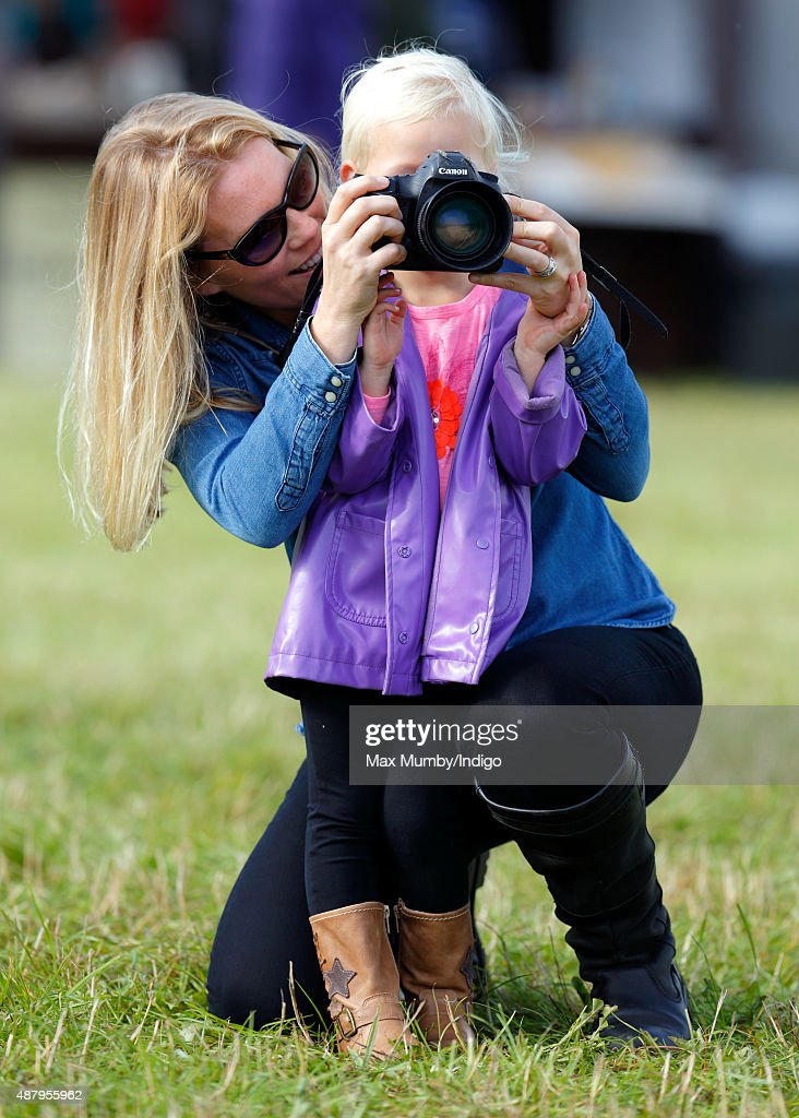 Autumn Phillips helps daughter Isla Phillips to take photographs as they attend day 2 of the Whatley Manor International Horse Trials at Gatcombe Park on September 12, 2015 in Stroud, England.