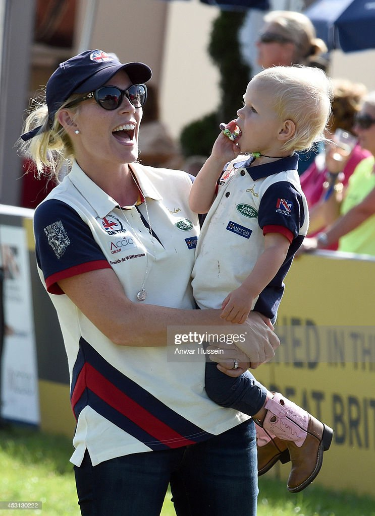 Autumn Phillips laughs as she holds daughter Isla Phillips during theFestival of British Eventing at Gatcombe Park on August 03, 2014 in Minchinhampton, England.