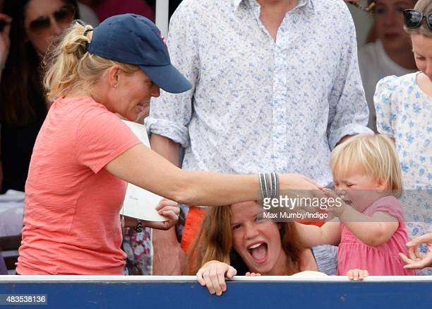 Autumn Phillips looks on as neice Mia Tindall pulls a girls hair on day 3 of the Festival of British Eventing at Gatcombe Park on August 9 2015 in...