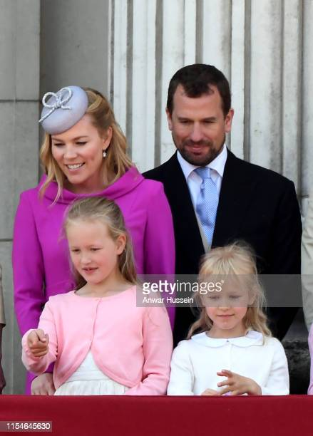 Autumn Phillips Peter Phillips and their children Savannah Phillips and Isla Phillips stand on the balcony of Buckingham Palace following Trooping...