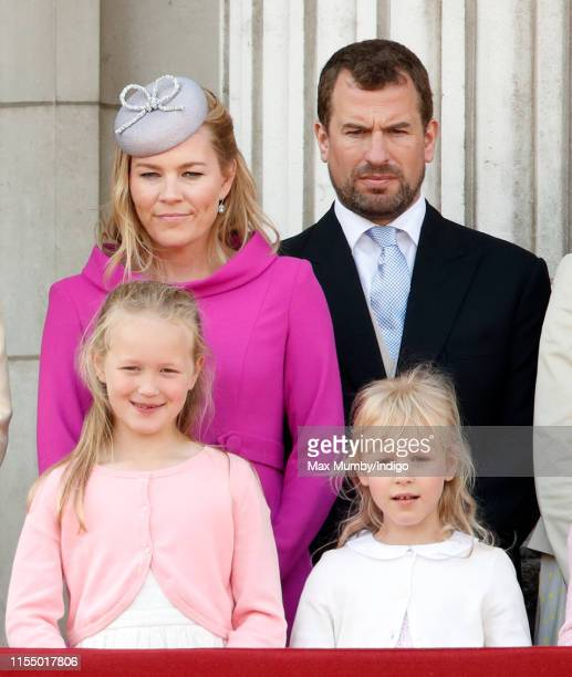 Autumn Phillips, Peter Phillips, Savannah Phillips and Isla Phillips watch a flypast from the balcony of Buckingham Palace during Trooping The...